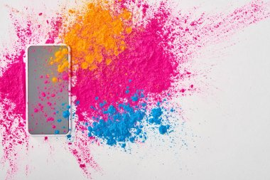 Top view of smartphone and explosion of multicolored holi powder on white background stock vector