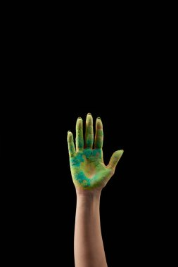 Cropped view of woman showing hand in green holi powder isolated on black stock vector