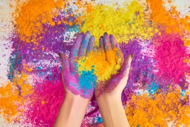 Cropped view of woman holding multicolored holi powder stock vector