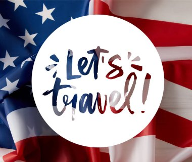 lets travel illustration with united states flag on background