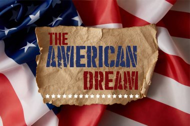 vintage crumpled paper with the american dream lettering on american flag