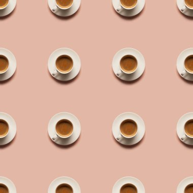 Top view of aromatic coffee in cups isolated on pink stock vector