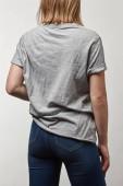 Fényképek a másol hely elszigetelt fehér fiatal nő alapvető szürke póló hátulnézet