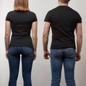 back view of young man and woman in black t-shirts with copy space isolated on grey