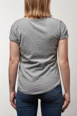Photo back view of young woman in grey t-shirt with copy space isolated on white