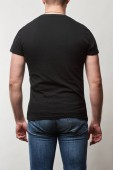 Photo back view of man in denim and black t-shirt with copy space isolated on grey