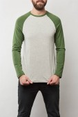 partial view of man in basic raglan sleeve baseball shirt with copy space isolated on grey