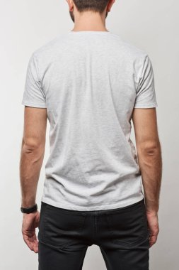 Back view of man in basic white t-shirt with copy space isolated on grey stock vector