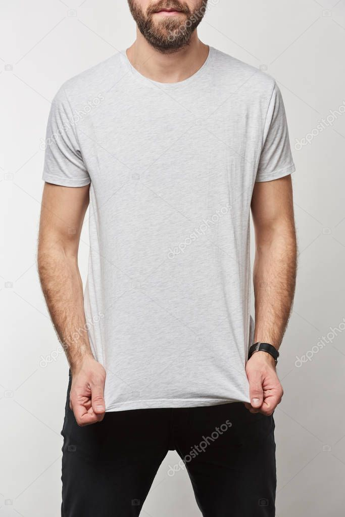 Partial view of bearded man in white t-shirt with copy space isolated on grey stock vector