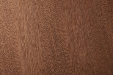 Top view of brown desk surface with wooden texture