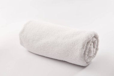 Terry soft rolled towel on white background
