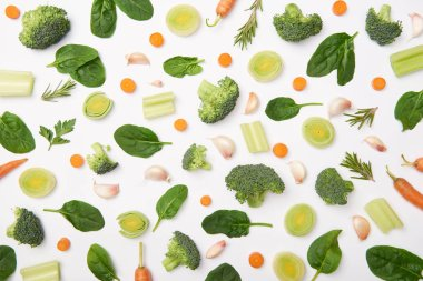 Flat lay with cut vegetables, rosemary and spinach leaves on white background stock vector