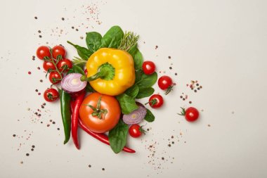 Top view of fresh vegetables and spices on grey background