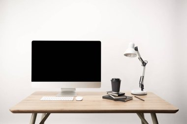 Workplace with lamp, coffee to go, notebooks and desktop computer with copy space isolated on white stock vector