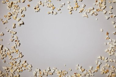 top view of tasty and salty popcorn lying isolated on white