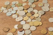 selective focus of different silver and golden coins on wooden background