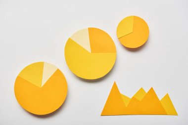Top view of paper yellow charts and graphs on white background stock vector
