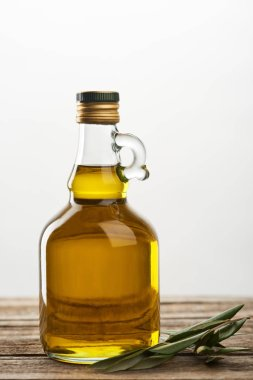 Bottle of oil and olive tree leaves  isolated on grey stock vector