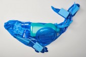 top view of whale made from disposable plastic tableware, bag, bottle, sponges and rubber gloves isolated on white