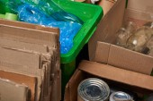 sorted trash of cardboard, glass and plastic bottles, polyethylene, iron cans