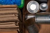 selective focus of cardboard, polyethylene, iron cans trash