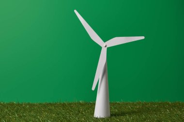 White windmill model on green grass and background stock vector
