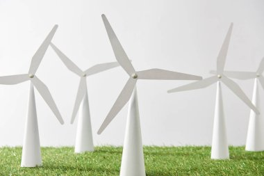 windmill models on grass and white background