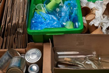 sorted trash of cardboard, glass and plastic bottles, polyethylene, cups, paper, iron cans