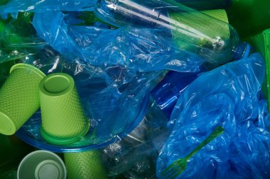 trash of plastic bottle, disposable tableware and polyethylene