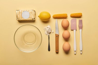 flat lay with kitchenware and ingredients on yellow background