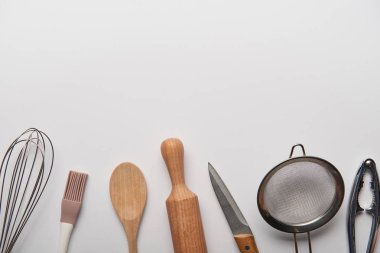 top view of cooking utensils on grey background