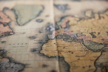 Selective focus of world retro map on table