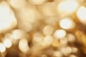 jasných světélek na zlaté pozadí