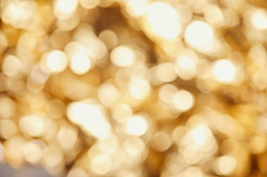 bright blurred twinkles and sparkles on golden background
