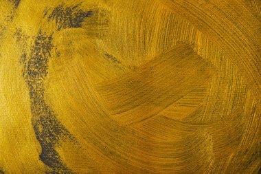 Different golden brushstrokes on dark textured background stock vector