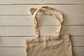 top view of empty cotton bag on white wooden surface, zero waste concept