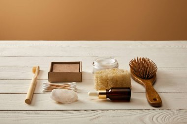 different hygiene and cosmetic items on white wooden surface, zero waste concept