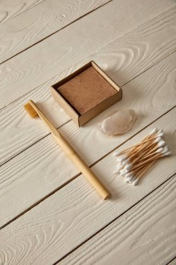various hygiene and cosmetic items on white wooden surface, zero waste concept