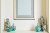 picture frame and turquoise set on shelf