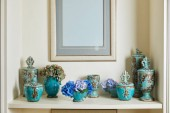 picture frame and turquoise set with flowers on surface with copy space