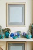picture frame and turquoise set with blue flowers on surface