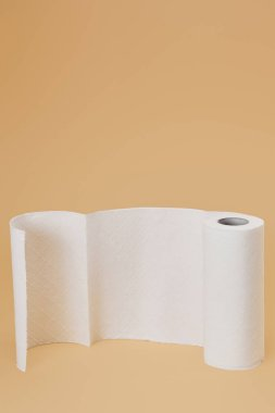 Roll of paper napkin on beige background stock vector