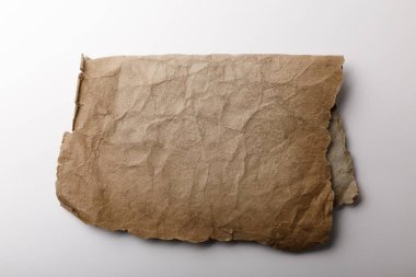 Top view of old parchment paper lying on white background stock vector