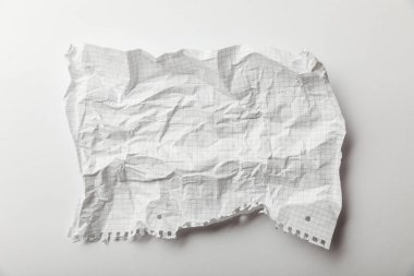 top view of blank squared crumpled page on white background