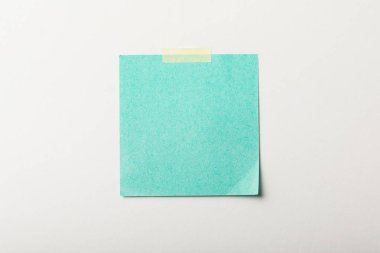 Turquoise blank sticker with sticky tape on white background stock vector