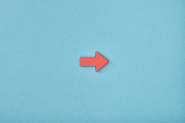 top view of red horizontal pointer on blue background
