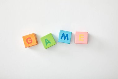 Top view of game lettering made of multicolored cubes on grey background stock vector