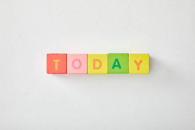 top view of today lettering made of multicolored cubes on white background