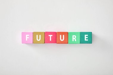 top view of future made of multicolored cubes on grey background