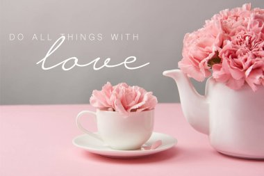 Pink carnation flowers in cup and teapot on grey background with do all things with love lettering stock vector
